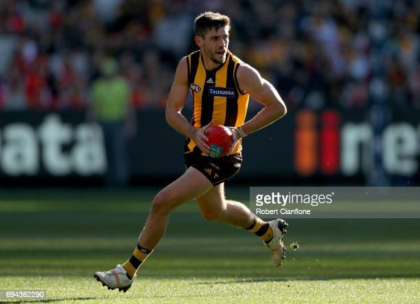 Ricky Henderson of the Hawks runs with the ball during the round 12 AFL match between the Hawthorn Hawks and the Gold Coast Suns at Melbourne Cricket...