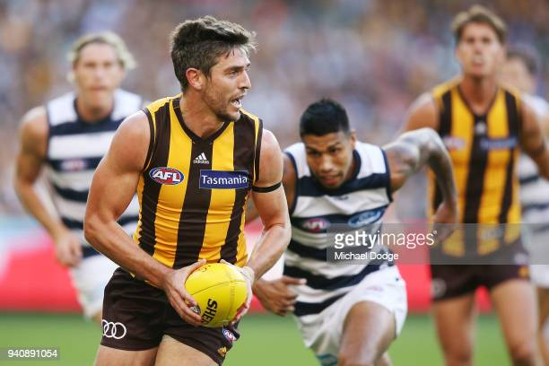Ricky Henderson of the Hawks runs with the ball during the round two AFL match between the Geelong Cats and the Hawthorn Hawks at Melbourne Cricket...
