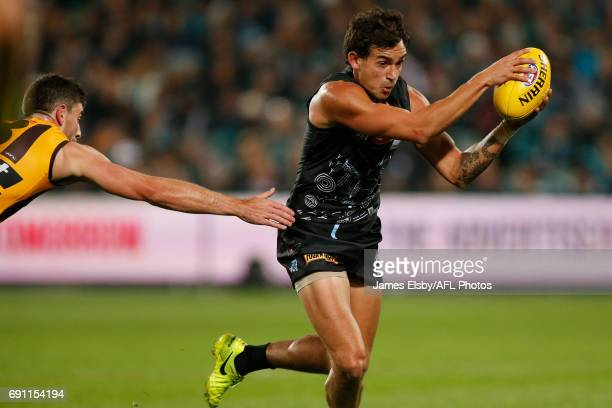 Ricky Henderson of the Hawks tackles Brendon Ah Chee of the Power during the 2017 AFL round 11 match between Port Adelaide Power and the Hawthorn...