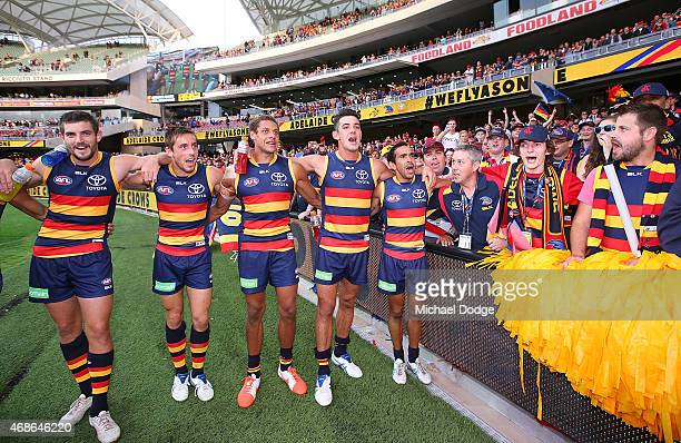 Ricky Henderson Richard Douglas CrowsCam EllisYolmen Taylor Walker and Eddie Betts of the Crows sing the club song with fans during the round one AFL...