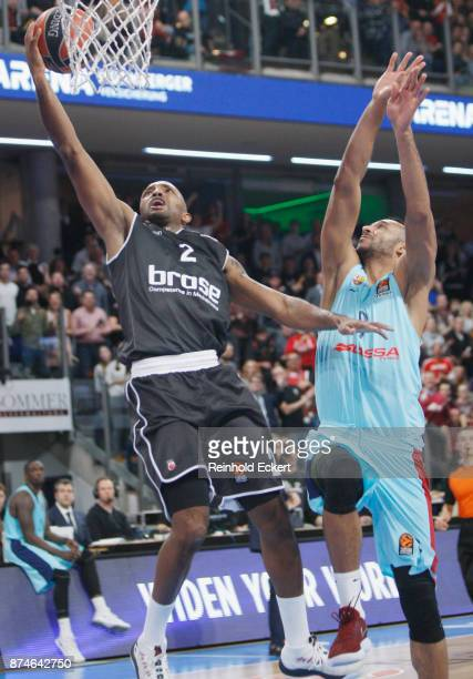 Ricky Hickman #2 of Brose Bamberg competes with Adam Hanga #9 of FC Barcelona Lassa in action during the 2017/2018 Turkish Airlines EuroLeague...
