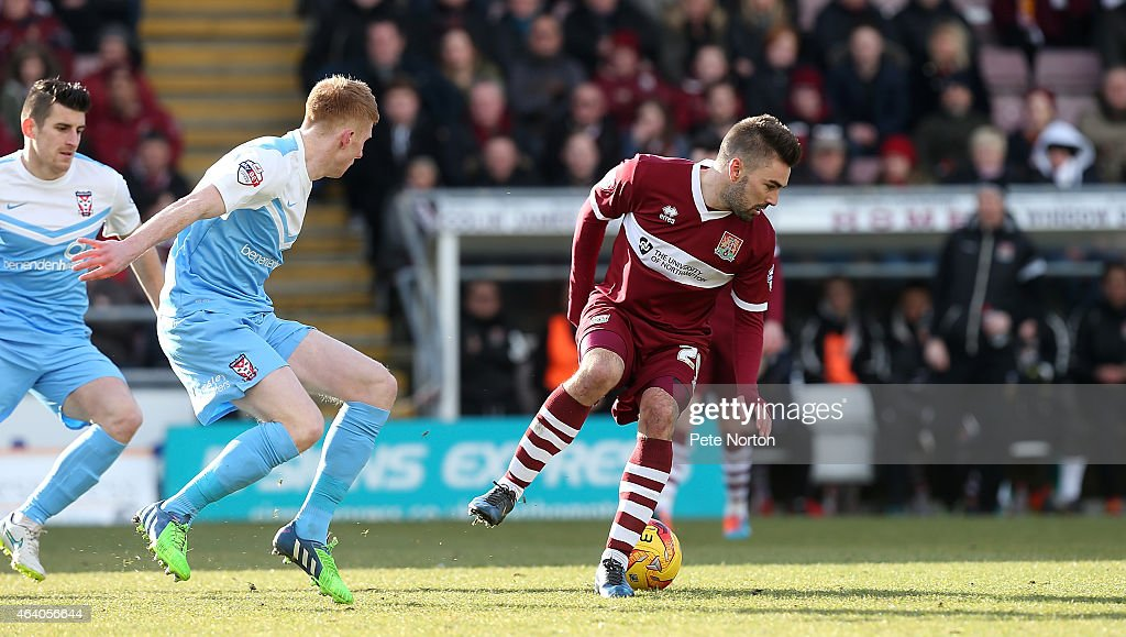 Ricky Holmes of Northampton Town attempts to control the ball watched by Brad Halliday of York City during the Sky Bet League Two match between Northampton Town and York City at Sixfields Stadium on February 21, 2015 in Northampton, England.