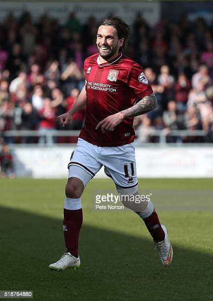 Ricky Holmes of Northampton Town celebrates after scoring his and his sides first goal during the Sky Bet League Two match between Northampton Town...