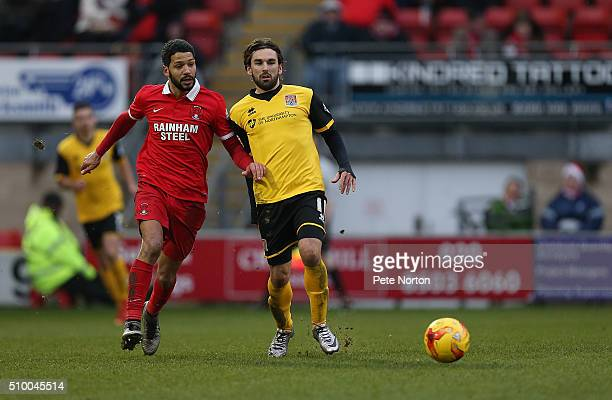 Ricky Holmes of Northampton Town looks to the ball with Jobi McAnuff of Leyton Orient during the Sky Bet League Two match between Leyton Orient and...