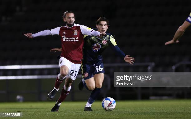 Ricky Holmes of Northampton Town moves forward with the ball away from Arthur Iontton of Stevenage during the Papa John's Trophy match between...