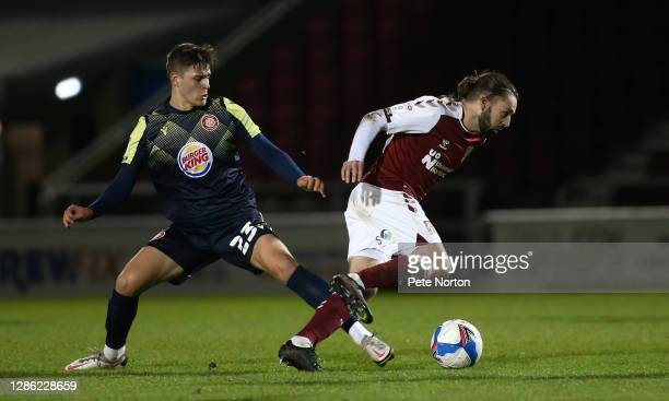 Ricky Holmes of Northampton Town moves with the ball past Jack Smith of Stevenage during the Papa John's Trophy match between Northampton Town and...