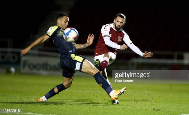 Ricky Holmes of Northampton Town plays the ball past Elliott List of Stevenage during the Papa John's Trophy match between Northampton Town and...