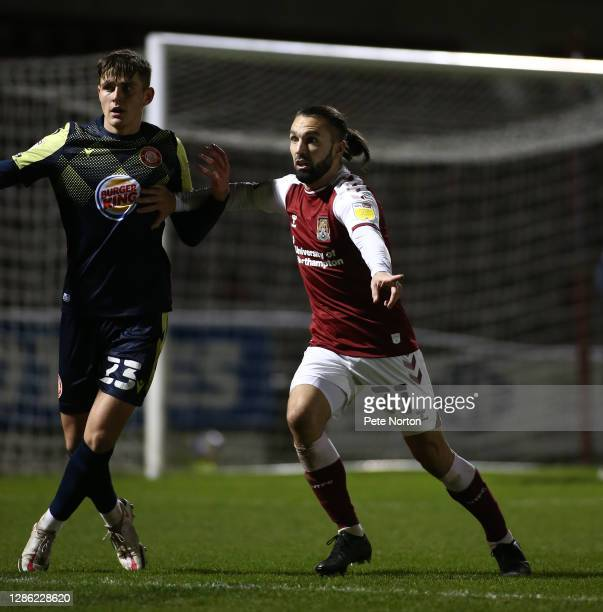 Ricky Holmes of Northampton Town with Jack Smith of Stevenage in action during the Papa John's Trophy match between Northampton Town and Stevenage at...