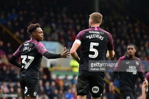 Ricky Jade-Jones of Peterborough United celebrates after scoring his team's second goal during the FA Cup Third Round match between Burnley FC and...