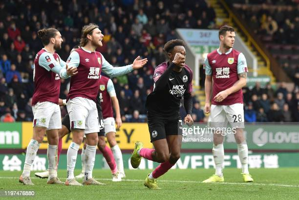 Ricky JadeJones of Peterborough United celebrates after scoring his team's second goal during the FA Cup Third Round match between Burnley FC and...