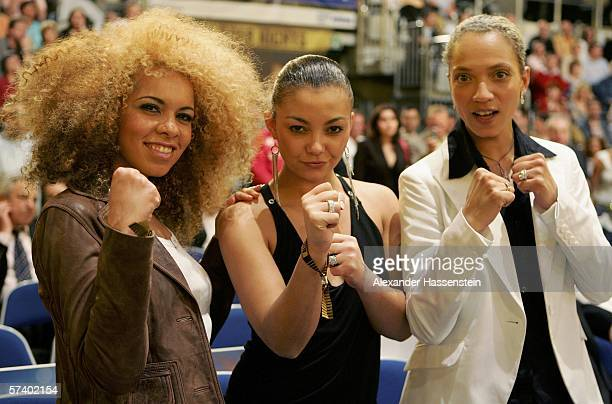 Ricky Jazzy and Lee from the German Girl Group 'Tic Tac Toe' pose during the IBF and vacant IBO World Haevyweight Championship fight between Chris...