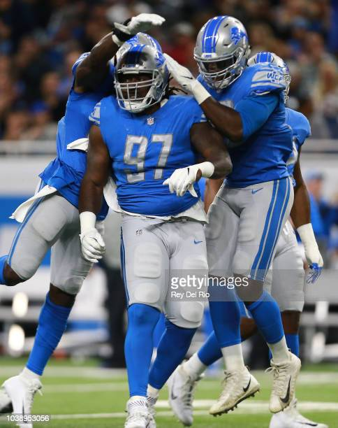 Ricky Jean Francois of the Detroit Lions celebrates a third down stop against the New England Patriots during the second quarter at Ford Field on...