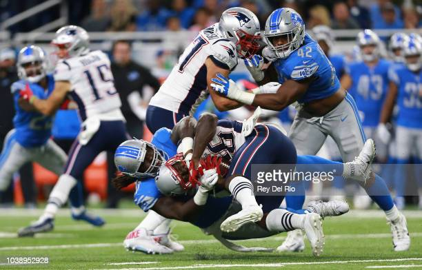 Ricky Jean Francois of the Detroit Lions makes a third down stop on Sony Michel of the New England Patriots during the second quarter at Ford Field...