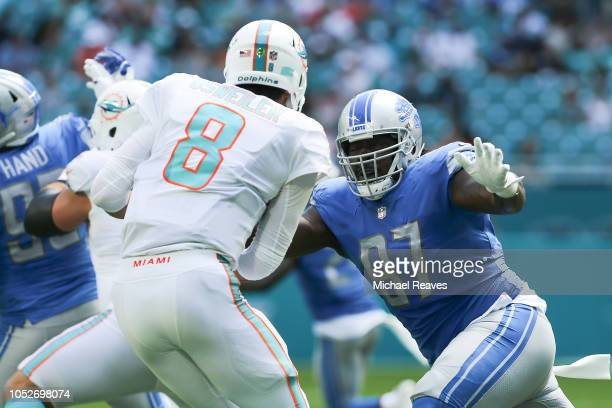 Ricky Jean Francois of the Detroit Lions sacks Brock Osweiler of the Miami Dolphins during the first half at Hard Rock Stadium on October 21 2018 in...