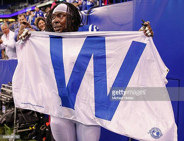 Ricky Jean Francois of the Indianapolis Colts celebrates with a flag honoring teammate Reggie Wayne who moved up to number 8 on the all time career...