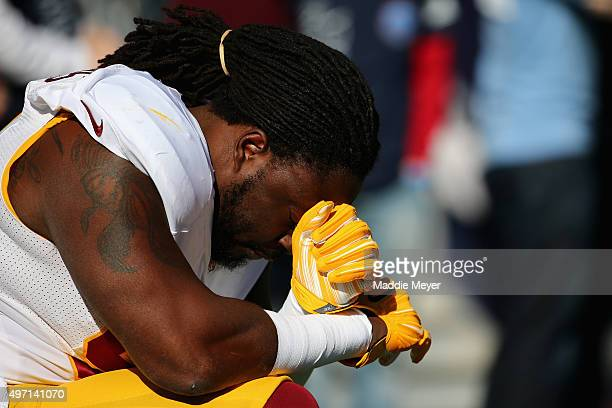 Ricky Jean Francois of the Washington Redskins says a prayer before the game against the New England Patriots at Gillette Stadium on November 8 2015...