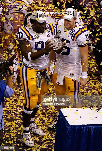 Ricky JeanFrancois and Matt Flynn of the Louisiana State University Tigers celebrate with the championship trophy after defeating the Ohio State...
