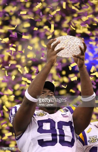 Ricky JeanFrancois of the Louisiana State University Tigers kisses the trophy after defeating the Ohio State Buckeyes 3824 in the AllState BCS...