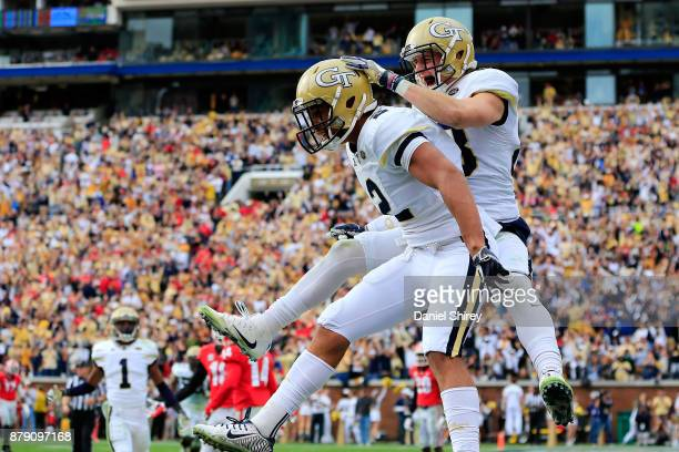 Ricky Jeune of the Georgia Tech Yellow Jackets celebrates a touchdown with Brad Stewart during the first half against the Georgia Tech Yellow Jackets...