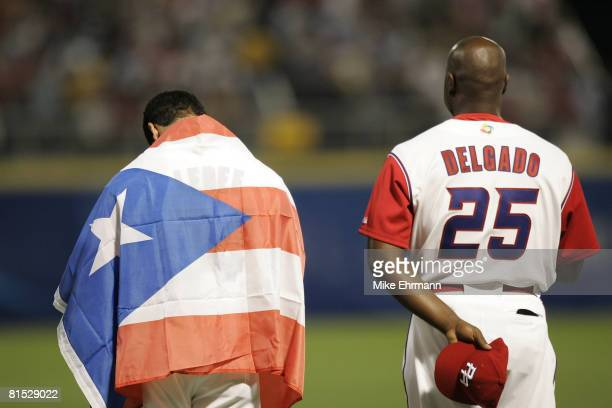 Ricky Ledee and Carlos Delgado of team Puerto Rico during a first round game against team Panama during the 2006 World Baseball Classic at Hiram...