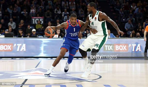 Ricky Ledo #1 of Anadolu Efes Istanbul competes with James Gist #14 of Panathinaikos Superfoods Athens during the 2017/2018 Turkish Airlines...