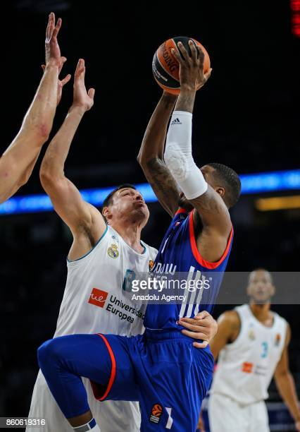 Ricky Ledo of Anadolu Efes in action against Jonas Maciulis of Real Madrid during the Turkish Airlines Euroleague basketball match between Anadolu...