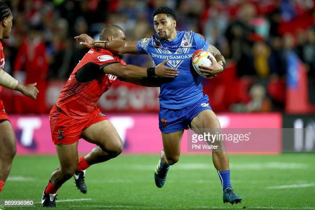 Ricky Leutele of Samoa is tackled during the 2017 Rugby League World Cup match between Samoa and Tonga at Waikato Stadium on November 4 2017 in...