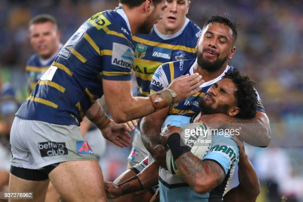 Ricky Leutele of the Sharks is tackled during the round three NRL match between the Parramatta Eels and the Cronulla Sharks at ANZ Stadium on March...