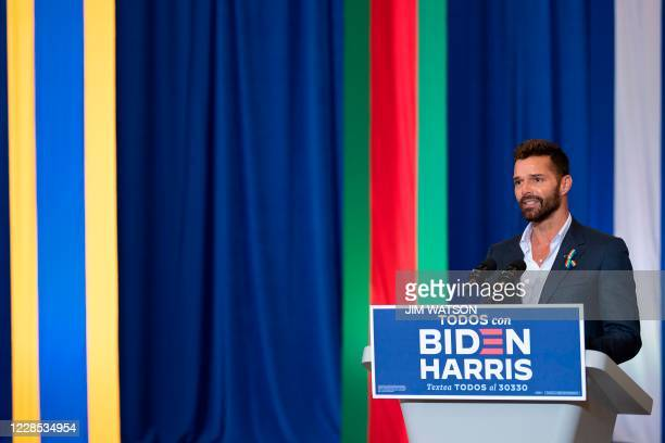 Ricky Martin, a Puerto Rican singer, songwriter, and humanitarian, speaks before Democratic Presidential Candidate Joe Biden as they participate in a...