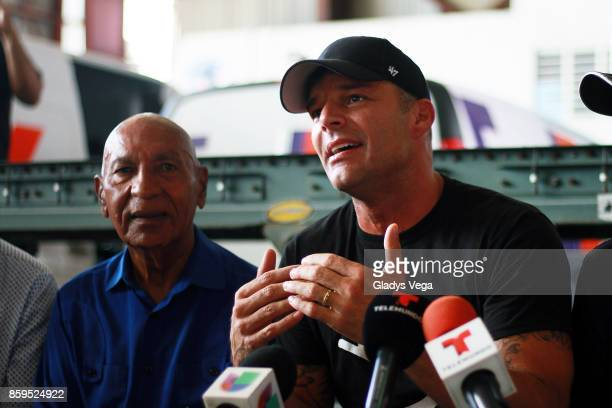 Ricky Martin and Mayor of Aguadilla Carlos Mendez speak to the media after Ricky Martin's arrival on a FedEx plane to bring aid for victims of...