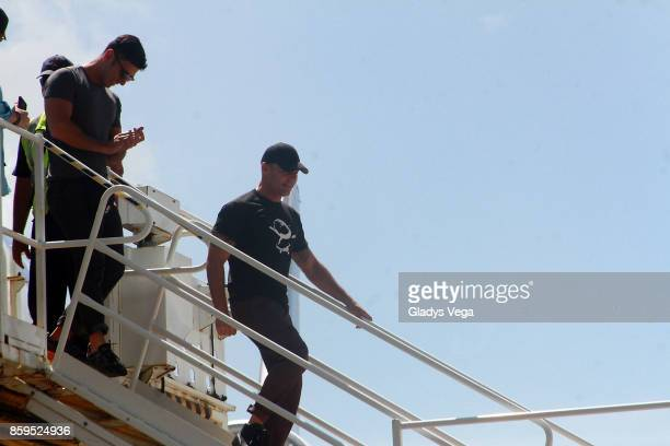 Ricky Martin and partner Jwan Yosef arrive on a FedEx plane to bring aid to Hurricane Maria victims at Rafael Hernandez Airport on October 9 2017 in...