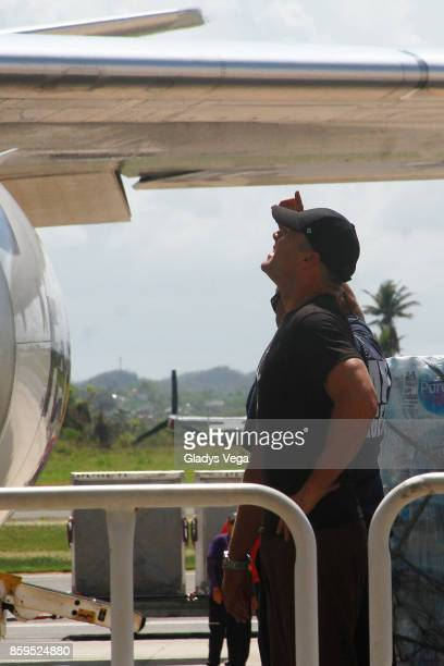 Ricky Martin arrives on a FedEx plane to bring aid to Hurricane Maria victims at Rafael Hernandez Airport on October 9 2017 in Aguadilla Puerto Rico