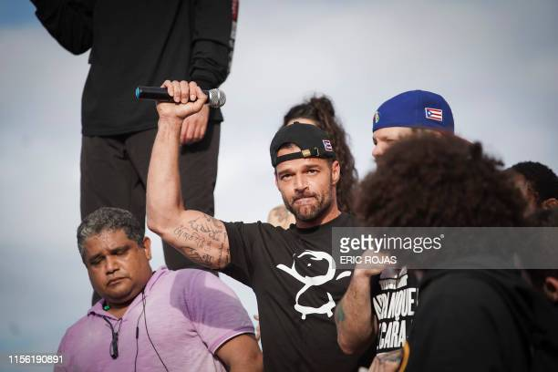 Ricky Martin gestures after speaking during a demonstration demanding Governor Ricardo Rossello's resignation in San Juan, Puerto Rico on July 17,...