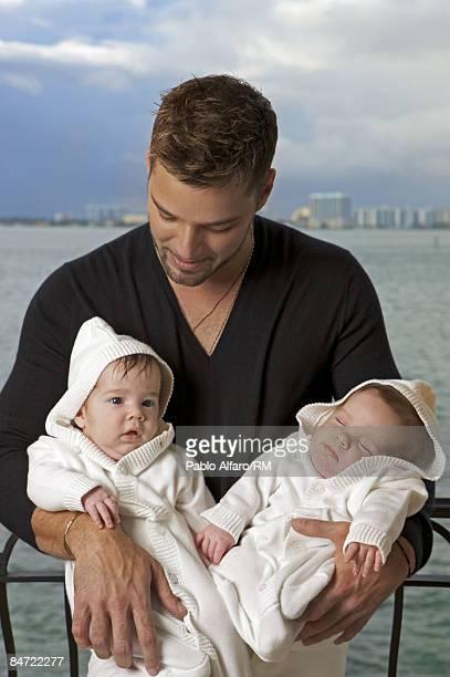 Ricky Martin poses with sons Valentino Martin and Matteo Martin on November 12, 2008 in Miami, Florida.