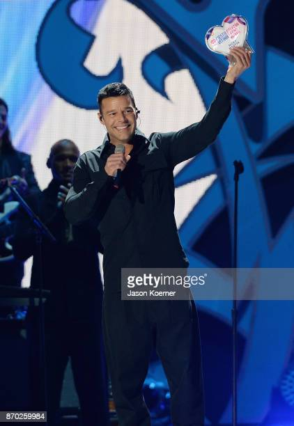 Ricky Martin recieves the Corazon Latino Award onstage during the iHeartRadio Fiesta Latina Celebrating Our Heroes at American Airlines Arena on...