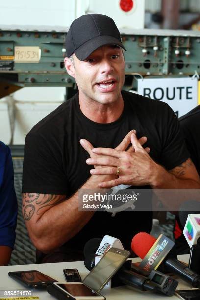 Ricky Martin speaks to the media after his arrival on a FedEx plane to bring aid to Hurricane Maria victims at Rafael Hernandez Airport on October 9...