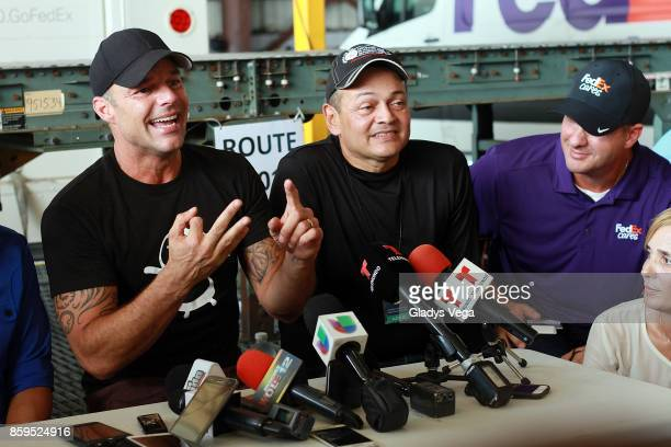 Ricky Martin talks to media after his arrival on a FedEx plane to bring aid to Hurricane Maria victims at Rafael Hernandez Airport on October 9 2017...