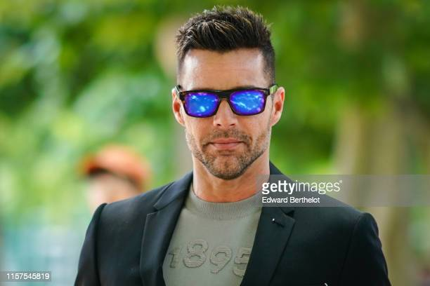 Ricky Martin wears blue reflective sunglasses, a blazer jacket, outside Berluti, during Paris Fashion Week - Menswear Spring/Summer 2020, on June 21,...