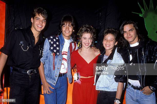 Ricky Martin with the group Menudo and Alyssa Milano