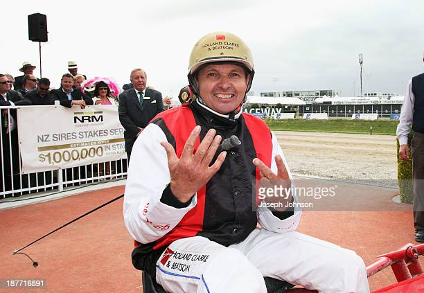Ricky May the driver of Terror to Love winner of the New Zealand Trotting Cup holds up 7 fingers representing 7 New Zealand Cup wins during New...
