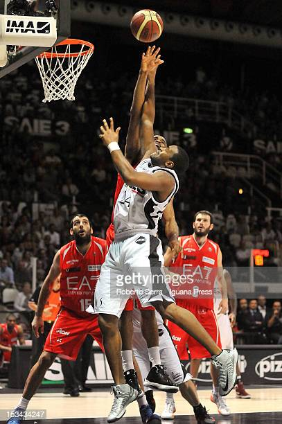 Ricky Minard of SAIE3 competes with Malik Hairston of EA7 during the Lega Basket Serie A match between SAIE3 Bologna and EA7 Emporio Armani Milano at...
