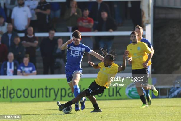 Ricky Modeste of Dover Athletic tackles Hartlepool United's Aaron Cunningham during the Vanarama National League match between Hartlepool United and...