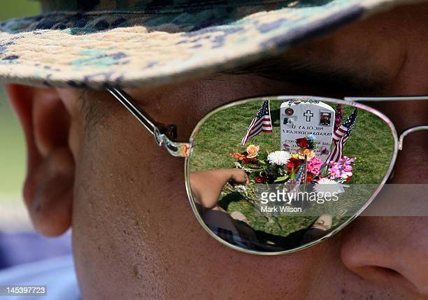 Ricky Parada sits at the grave of his little brother Cpl Nicolas D Paradarodriguez who was killed in Afghanistan at Section 60 on Memorial Day at...