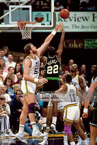 Ricky Pierce of the Milwaukee Bucks shoots against Mark Eaton of the Utah Jazz circa 1990 at the Salt Palace in Salt Lake City Utah NOTE TO USER User...