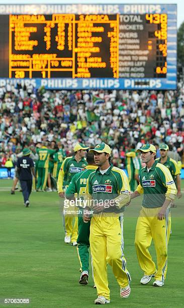 Ricky Ponting captain of Australia leads his team from the field as the scoreboard shows South Africa's World Record score of 438 during the fifth...