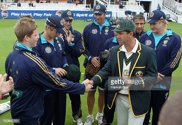 Ricky Ponting captain of Australia presents the Baggy Green Cap to debutant Steven Smith of Australia ahead of day one of the First Test between...