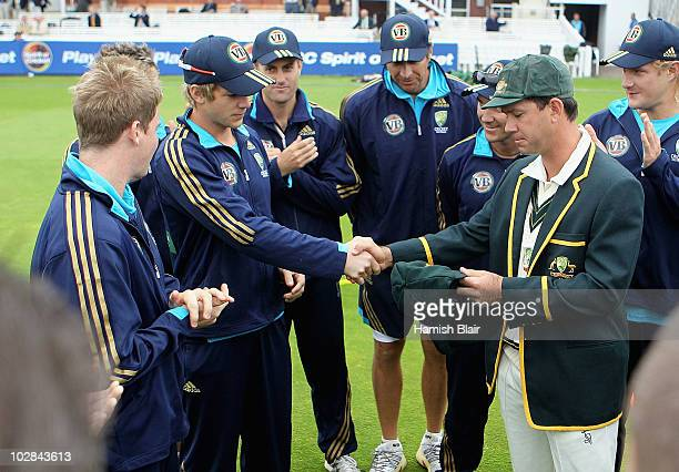 Ricky Ponting captain of Australia presents the Baggy Green Cap to debutant Tim Paine of Australia ahead of day one of the First Test between...