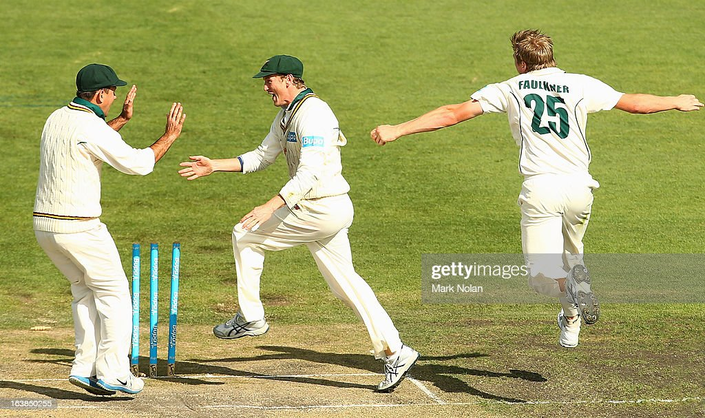 Ricky Ponting, George Bailey and James Faulkner of Tasmania celebrate the run out of Cameron White of Victoria by Bailey during day four of the Sheffield Shield match between the Tasmania Tigers and the Victoria Bushrangers at Blundstone Arena on March 17, 2013 in Hobart, Australia.