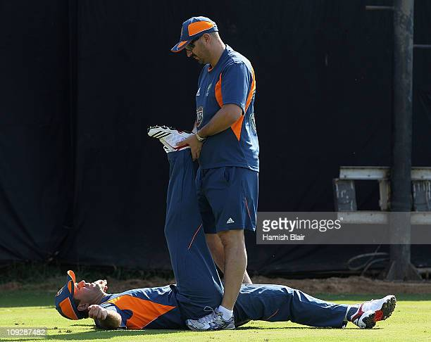 Ricky Ponting is assisted with his warm up by physio Alex Kountouris during an Australian nets session at Sardar Patel Stadium on February 19 2011 in...