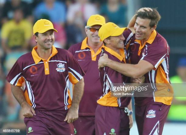 Ricky Ponting looks on as AFL footballer Brent Harvey congratulates Matthew Richardson after he dismissed Adam Gilchrist during the Ricky Ponting...